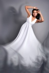 portrait of a beautiful dark-skinned woman in a white dress